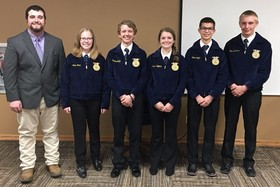 Monday, at the November 13th school board meeting, Mr. Johnson, FFA Instructor and the FFA officers pictured (L to R): Mr. Johnson, Alexa Brain, Creed Griffin, Brekken Hoffman, Colter Wright, and James Garetson) shared about their trip to National FFA Con